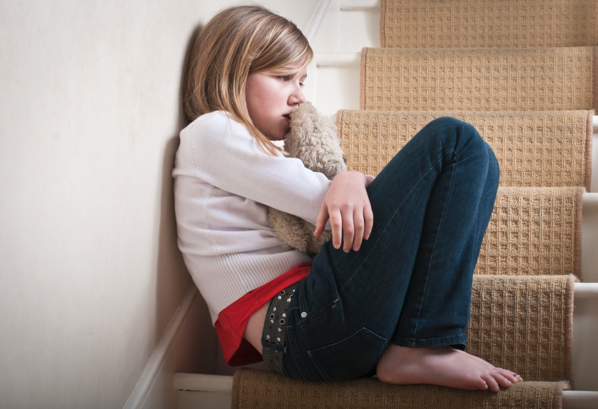 A little girl upset from family law matters